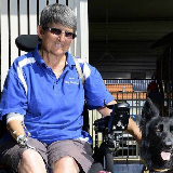 One armed Jo Morgan in her wheelchair