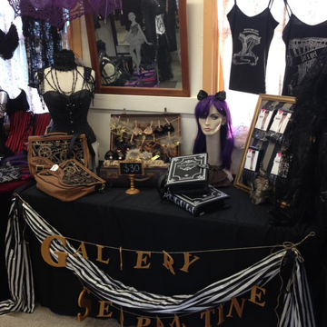 Our very cute table display at Goulburn complete with kitty ears and custom corset t-shirts and singlets