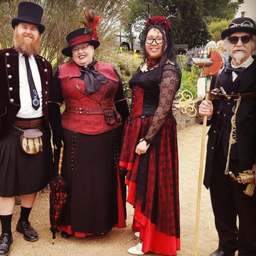 Crimson Pirate tailcoat on the gentleman on the left and our photographer Nancy Trieu in full Gallery Serpentine attire with the huntress head dress