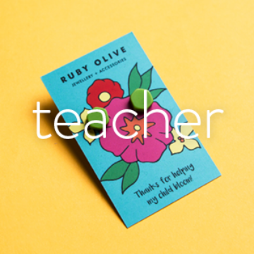Best Selling Gifts for Teachers | Green stud earrings on yellow background