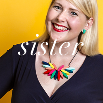 Best Selling Gifts for Sisters | Smiling blonde model wearing Colourful Jewellery