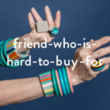 Best Selling Gifts for Hard to Buy for Friends | Hands wearing colourful rings and bangles
