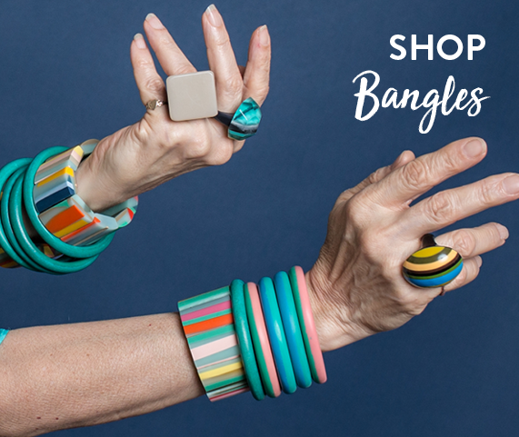 Shop by bangles | Two wrists wearing multicoloured resin bangles