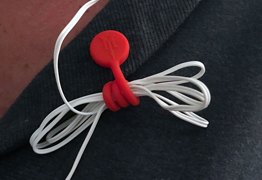 TwistieMag used as a magnetic earphone cord containment clip