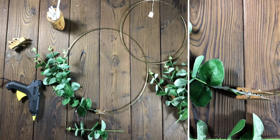 start arranging and gluing the branches along the hoop
