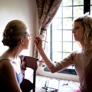 nikki hynek doing wedding day makeup for bride bridesmaids wedding party