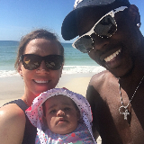 Lauren, Jrue, and their daughter JT Holiday