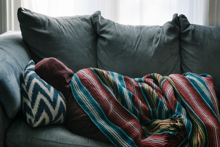 Person napping on a couch