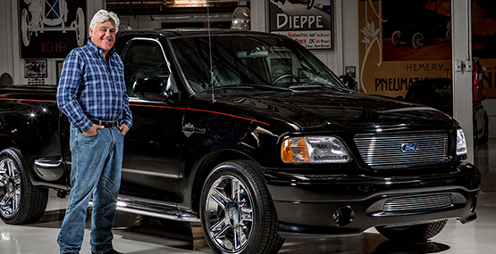 jay Leno next to a ford truck