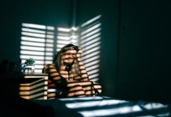 Woman sitting in a corner