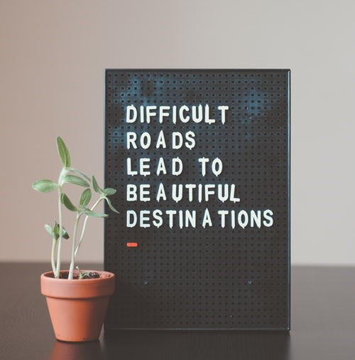 Sign that says difficult roads lead to beautiful destinations