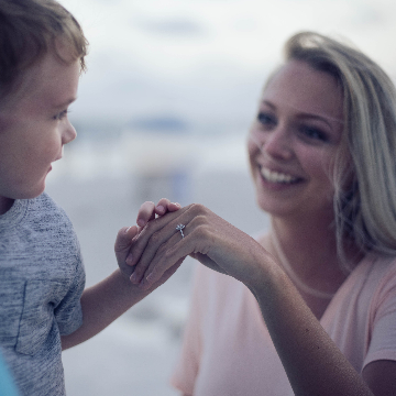 Woman Smiling with Kid