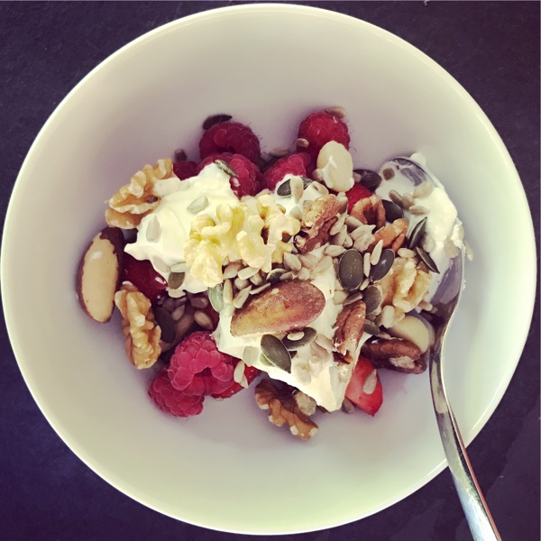 yoghurt with berries, nuts, and seeds