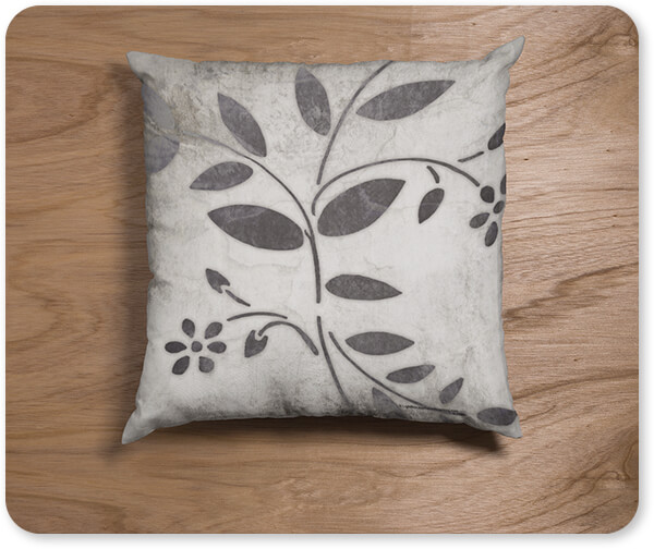 Patterns Collection Leaf Pattern Square Pillow Lying on a Wooden Surface