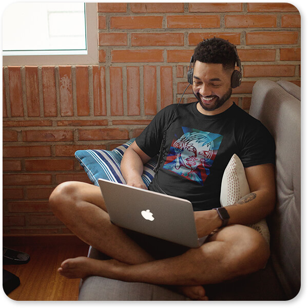 Retro Abstract and Faces Collection Music Musician DJ T-Shirt of a Man Listening to Music Using His Laptop at Home with Headphones