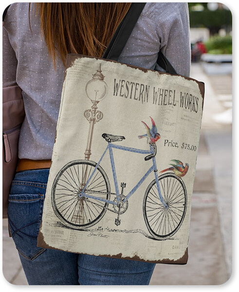 Canvas Tote Bag Over a Woman's Shoulder Western Wheels Works Bicycle