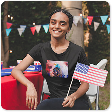 Jai Johnson Artist Collection Smiling Black Woman Wearing a Tshirt Holding a Small American Flag at a 4th of July BBQ Party Jazzy Animal Bald Eagle United States