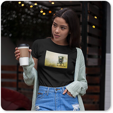 Jai Johnson Artist Collection Amish Wagon Tshirt of an Asian Girl Having a Coffee Outdoors in cut off blue jeans