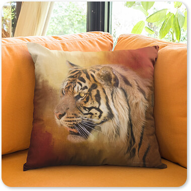 Jai Johnson Artist Collection Square Pillow Template Lying on an Orange Sofa in a Living Room - Greeting November Bengal Tiger