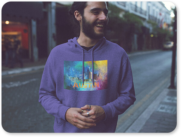 Sending Love To the Cities Collection Austin - Hoodie - Pullover Hoodie Mockup of a Handosme Young Man with Long Hair Laughing in the City