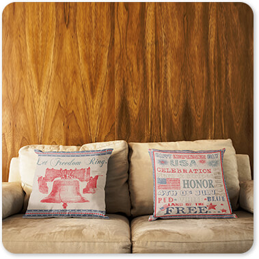 Jean Plout Artist Collection Vintage America Collection 4th of July on Flour Sack Let Freedom Ring Liberty Bell Pair of Pillows Lying on a Sofa Against a Wooden Wall copy