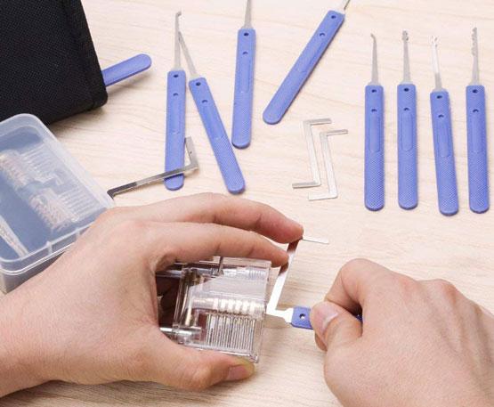 Lokko Lock Pick Set on table, hands picking padlock