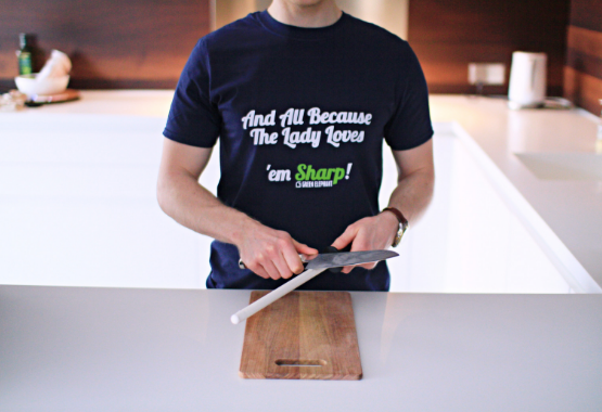 A man using ceramic honing steel by Green Elephant Kitchen