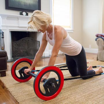 Working out with Pilates Wheel in living room